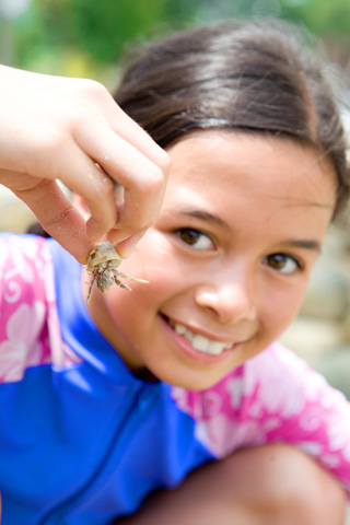 Young girl showing her little crab